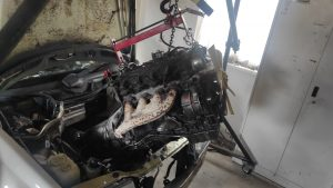 M102 engine removed. space for the V8 turbo 32